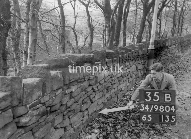 SD980435B2, Man marking Ordnance Survey minor control revision point with an arrow in 1950s