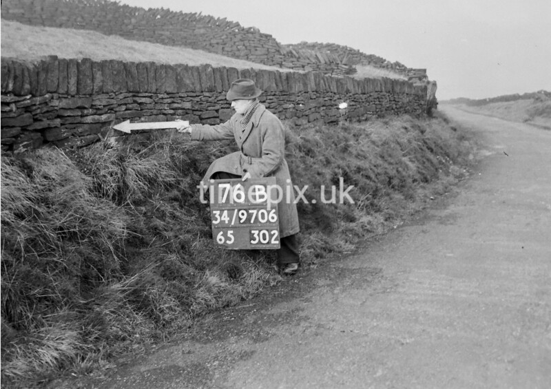 SD970676B, Man marking Ordnance Survey minor control revision point with an arrow in 1950s