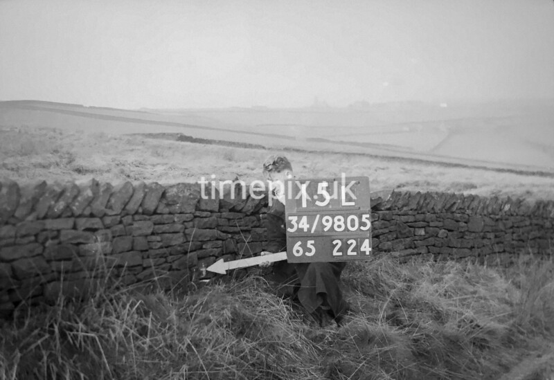SD980515L, Man marking Ordnance Survey minor control revision point with an arrow in 1950s