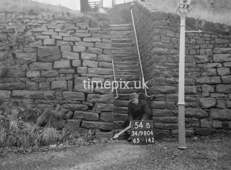 SD980454B, Man marking Ordnance Survey minor control revision point with an arrow in 1950s