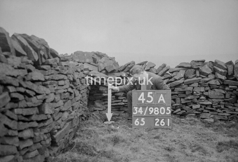 SD980545A, Man marking Ordnance Survey minor control revision point with an arrow in 1950s