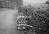 SD990496A, Man marking Ordnance Survey minor control revision point with an arrow in 1950s