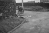 SD990649B, Man marking Ordnance Survey minor control revision point with an arrow in 1950s