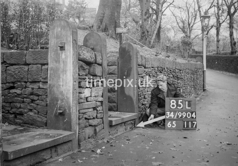 SD990485L, Man marking Ordnance Survey minor control revision point with an arrow in 1950s