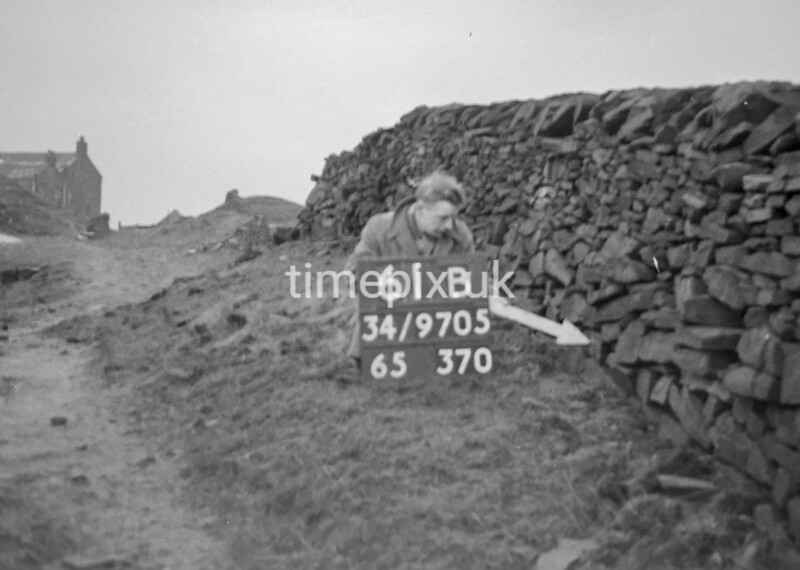 SD970561B, Man marking Ordnance Survey minor control revision point with an arrow in 1950s
