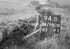 SD980894B, Man marking Ordnance Survey minor control revision point with an arrow in 1950s