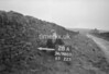 SD980528A, Man marking Ordnance Survey minor control revision point with an arrow in 1950s