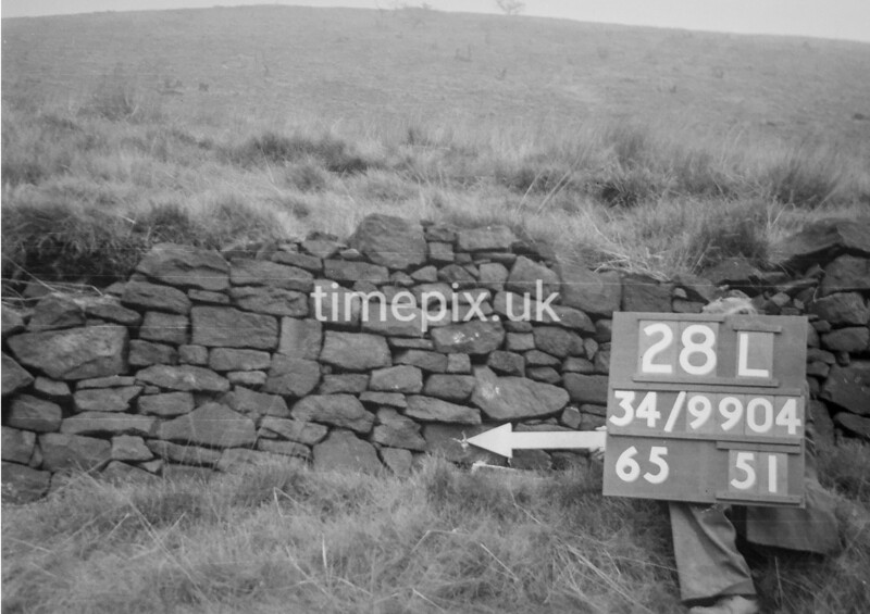 SD990428L, Man marking Ordnance Survey minor control revision point with an arrow in 1950s