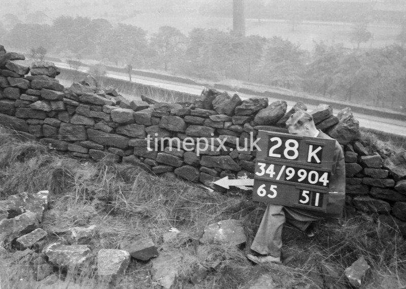 SD990428K, Man marking Ordnance Survey minor control revision point with an arrow in 1950s