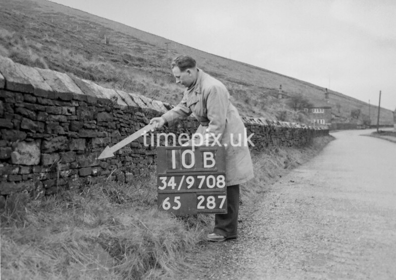 SD970810B, Man marking Ordnance Survey minor control revision point with an arrow in 1950s