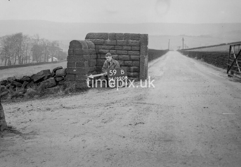 SD990859B2, Man marking Ordnance Survey minor control revision point with an arrow in 1950s