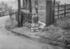 SD990637B2, Man marking Ordnance Survey minor control revision point with an arrow in 1950s