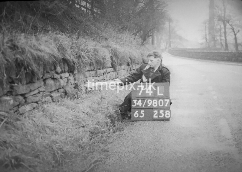 SD980774L, Man marking Ordnance Survey minor control revision point with an arrow in 1950s