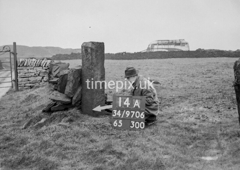 SD970614A, Man marking Ordnance Survey minor control revision point with an arrow in 1950s