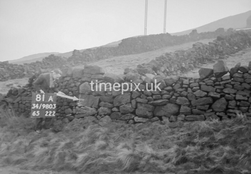 SD980381A, Man marking Ordnance Survey minor control revision point with an arrow in 1950s