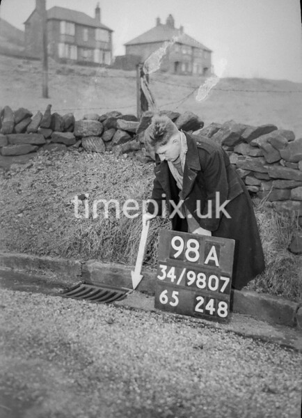 SD980798A, Man marking Ordnance Survey minor control revision point with an arrow in 1950s