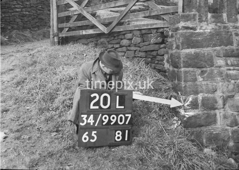 SD990720L, Man marking Ordnance Survey minor control revision point with an arrow in 1950s
