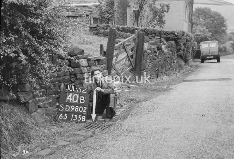 SD980240B, Man marking Ordnance Survey minor control revision point with an arrow in 1950s