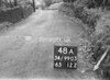 SD990348A, Man marking Ordnance Survey minor control revision point with an arrow in 1950s