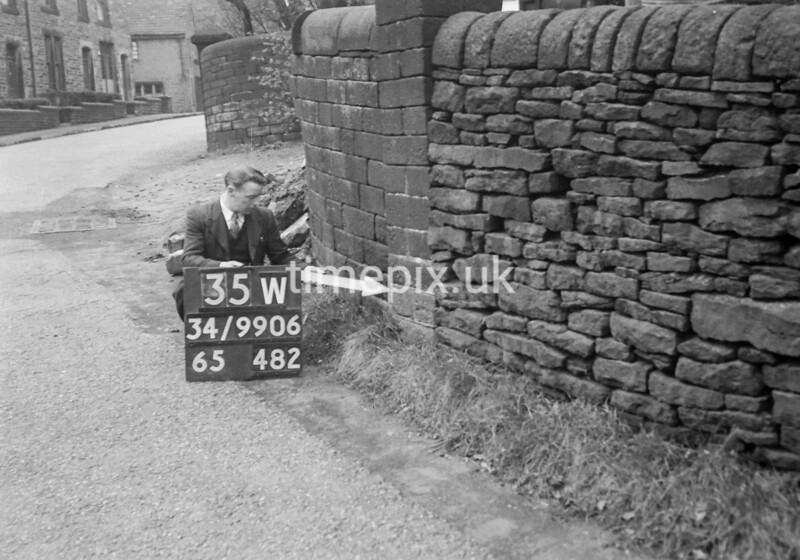 SD990635W1, Man marking Ordnance Survey minor control revision point with an arrow in 1950s