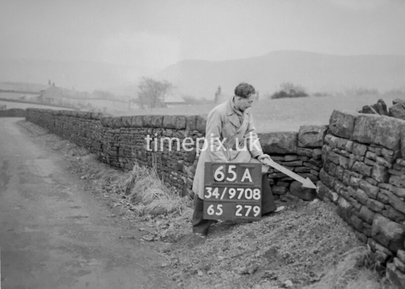 SD970865A1, Man marking Ordnance Survey minor control revision point with an arrow in 1950s
