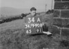 SD990834A2, Man marking Ordnance Survey minor control revision point with an arrow in 1950s