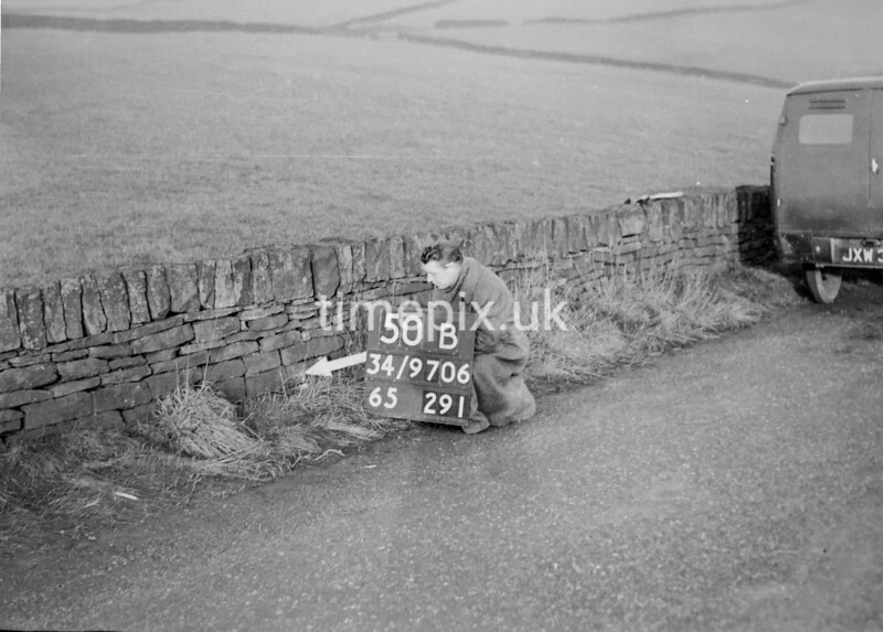 SD970650B, Man marking Ordnance Survey minor control revision point with an arrow in 1950s