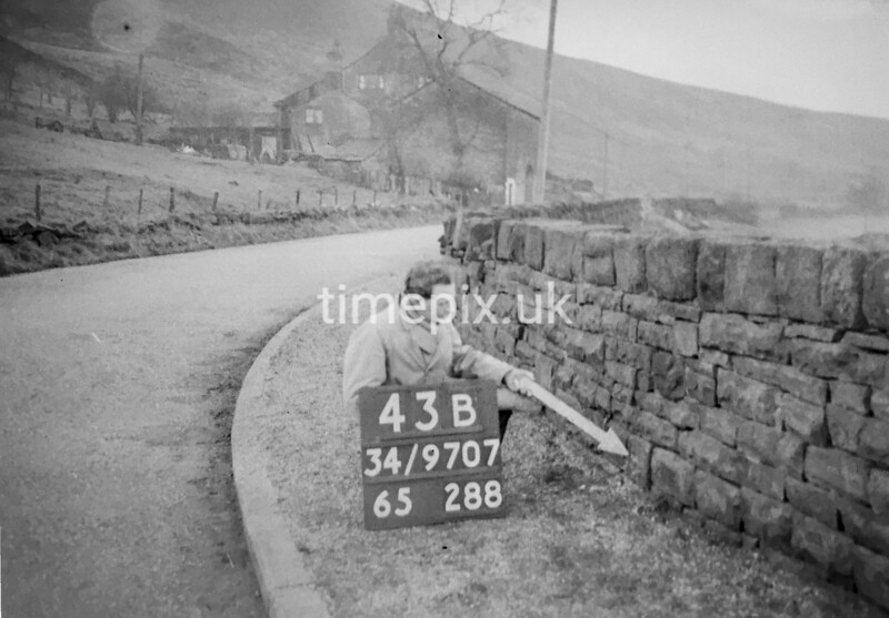 SD970743B, Man marking Ordnance Survey minor control revision point with an arrow in 1950s