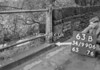 SD990663B, Man marking Ordnance Survey minor control revision point with an arrow in 1950s