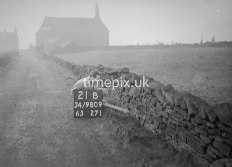 SD980921B, Man marking Ordnance Survey minor control revision point with an arrow in 1950s