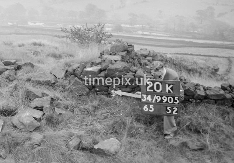 SD990520K, Man marking Ordnance Survey minor control revision point with an arrow in 1950s