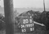 SD990720B, Man marking Ordnance Survey minor control revision point with an arrow in 1950s