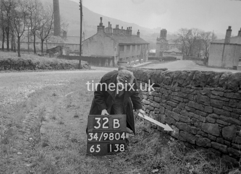 SD980432B, Man marking Ordnance Survey minor control revision point with an arrow in 1950s