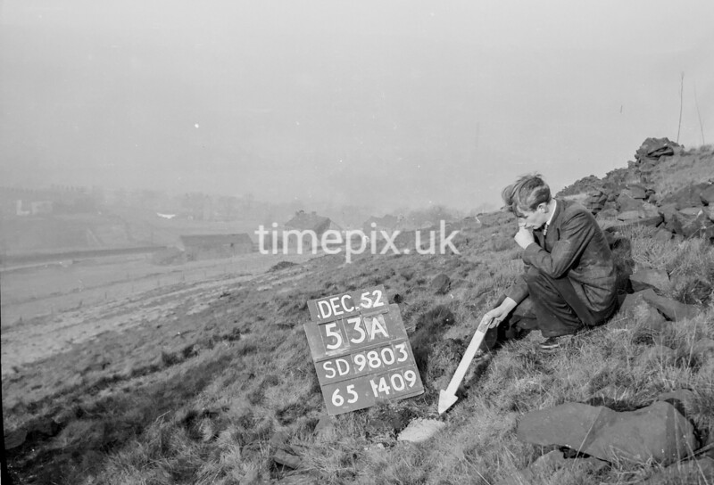 SD980353A1, Man marking Ordnance Survey minor control revision point with an arrow in 1950s