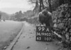 SD990399A, Man marking Ordnance Survey minor control revision point with an arrow in 1950s