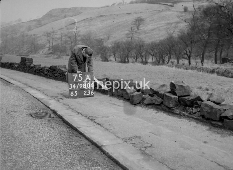 SD980675A, Man marking Ordnance Survey minor control revision point with an arrow in 1950s