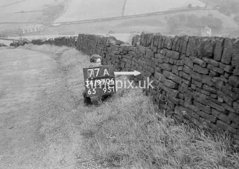 SD970677A, Man marking Ordnance Survey minor control revision point with an arrow in 1950s