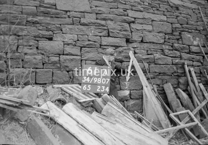 SD980761A, Man marking Ordnance Survey minor control revision point with an arrow in 1950s