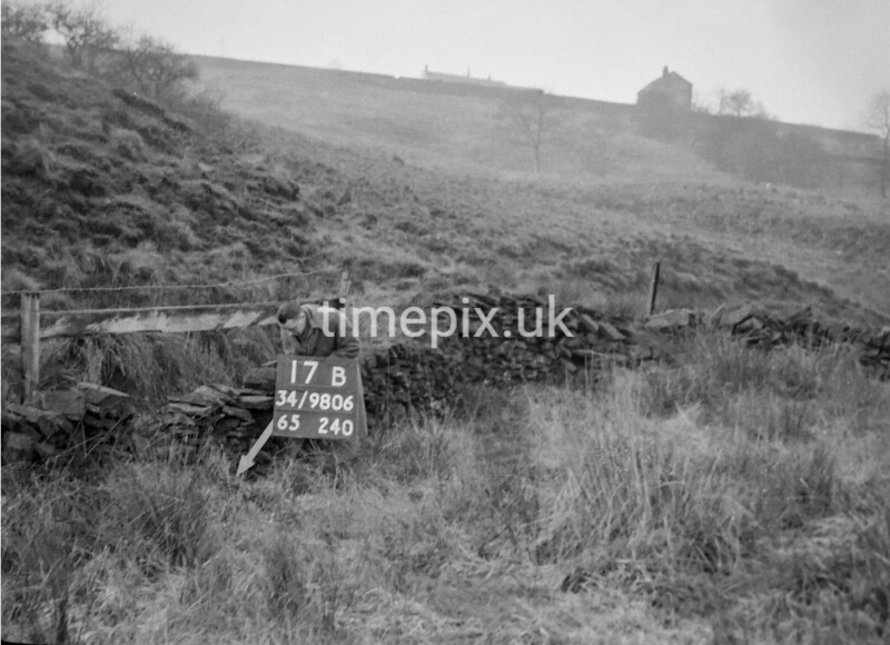 SD980617B, Man marking Ordnance Survey minor control revision point with an arrow in 1950s