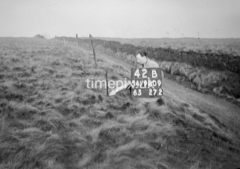 SD980942B, Man marking Ordnance Survey minor control revision point with an arrow in 1950s