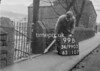 SD990399B, Man marking Ordnance Survey minor control revision point with an arrow in 1950s