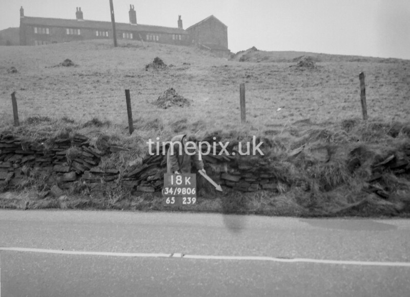 SD980618K, Man marking Ordnance Survey minor control revision point with an arrow in 1950s