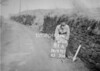 SD970781A, Man marking Ordnance Survey minor control revision point with an arrow in 1950s