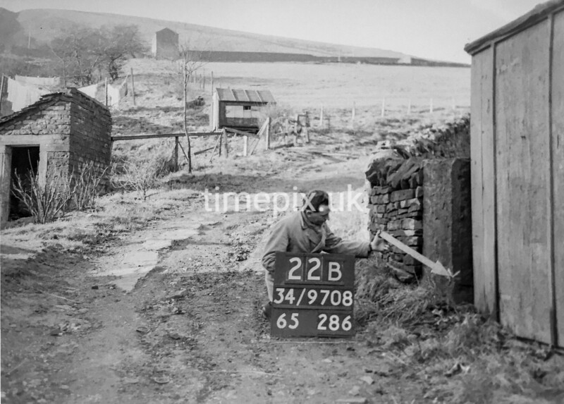 SD970822B, Man marking Ordnance Survey minor control revision point with an arrow in 1950s