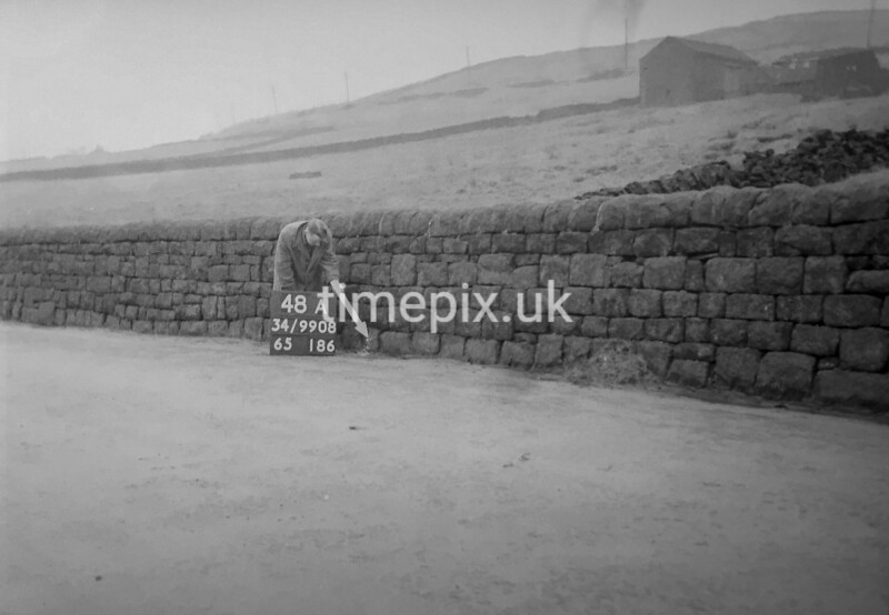 SD990848A, Man marking Ordnance Survey minor control revision point with an arrow in 1950s