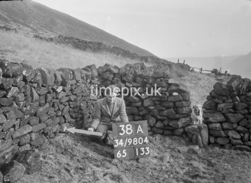 SD980438A, Man marking Ordnance Survey minor control revision point with an arrow in 1950s