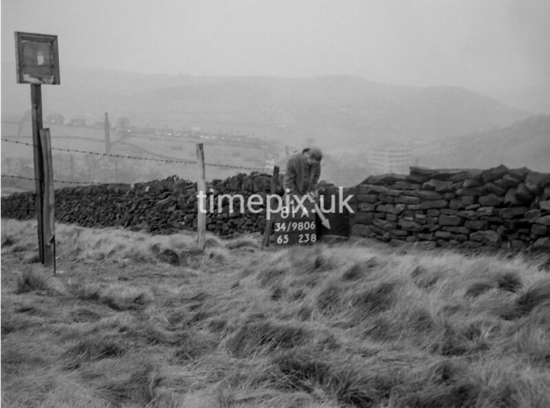 SD980681A, Man marking Ordnance Survey minor control revision point with an arrow in 1950s
