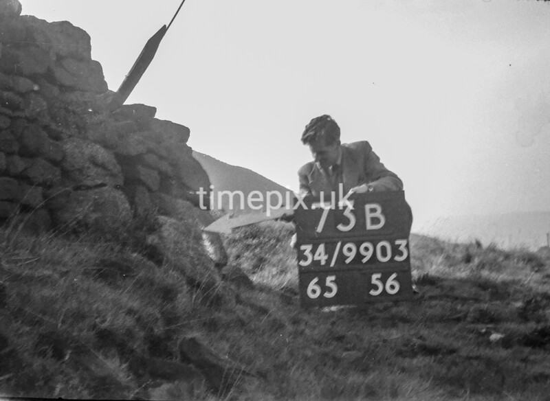 SD990373B, Man marking Ordnance Survey minor control revision point with an arrow in 1950s