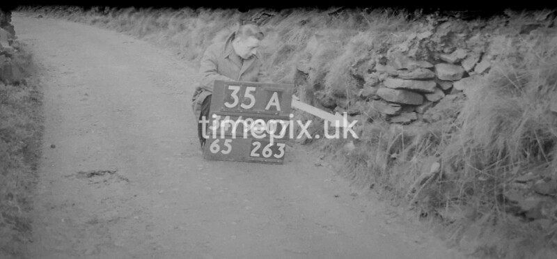 SD980735A, Man marking Ordnance Survey minor control revision point with an arrow in 1950s
