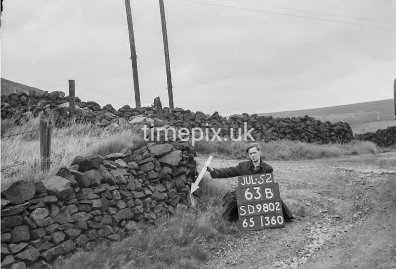 SD980263B, Man marking Ordnance Survey minor control revision point with an arrow in 1950s